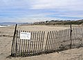 Fencing and signage at Dockweiler State Beach. (34405027181).jpg