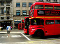 First London Routemaster bus RM1204 (204 CLT) heritage route 9 Trafalgar Square 2 August 2007 with bendybus and phone box.jpg