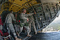 First Lt. Andrew McCornack moves down the ramp of a CH47 Chinook helicopter to exit the aircraft.jpg