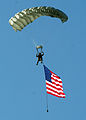 Flickr - DVIDSHUB - Parachutists deliver American flag for Rodeo opening ceremony (Image 1 of 4).jpg