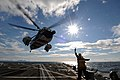 Flickr - Official U.S. Navy Imagery - A Sailor communicates to the pilots of a Royal British navy helicopter..jpg