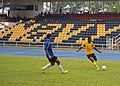 Flickr - Official U.S. Navy Imagery - A Sailor plays soccer during a sports day event hosted by members of the Royal Malaysian navy..jpg