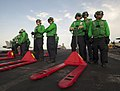 Flickr - Official U.S. Navy Imagery - Sailors wait to move stores during vertical replenishment..jpg