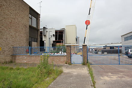 Plessey Semiconductors factory at Cheney Manor, Swindon, on 17 July 2012, undergoing demolition Former Plessey Microelectronics Factory Swindon.jpg