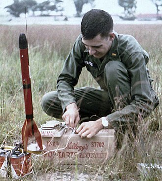 Forrest Mims - Forrest Mims preparing an Estes Big Bertha model rocket for launch near Saigon, Vietnam in 1967