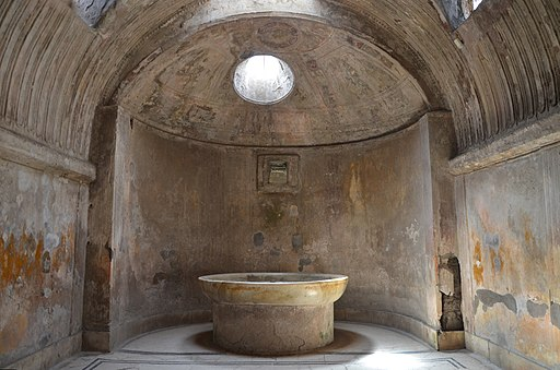 Forum Baths, the apse of the caldarium (hot bath room) containing a labrum or (marble basin), Pompeii (14832295629)