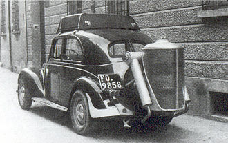 Wood economy - A car built in the 1940s by Ilario Bandini, with a wood gas generator device.