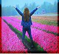 Georgina Lara Booth standing in tulip field.jpg