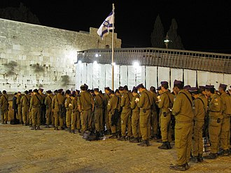 Jewish prayer - Members of the Israel Defense Forces' Givati Brigade pray the Evening Service (Ma'ariv) at the Western Wall, October 2010.