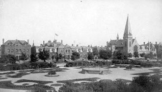 Solon Spencer Beman - Arcade Park in Pullman surrounded by picturesque buildings in historical styles, including the Gothic Revival Greenstone Church.