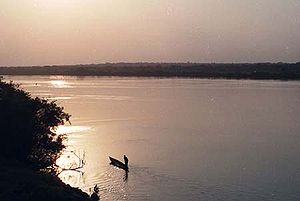 A canoe on the Niger River at sunset, Guinea