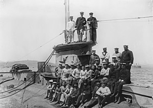 Crew of E14, seen after leaving the Dardanelles straits in 1915. Lt-Cmdr Boyle is standing at centre on the conning tower.