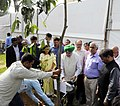 Hardeep Singh Puri participating in a tree plantation drive, at the handing over ceremony of possession to allottees of the new government flats at East Kidwai Nagar, in New Delhi.JPG