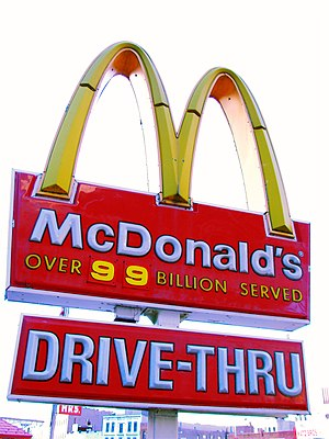"Rationalization (sociology) - The sign at a McDonald's 'drive-thru'. The ""over 99 billion served"" statement illustrates Ritzer's idea of calculability."