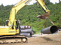 Heavy equipment hauling pipe.JPG