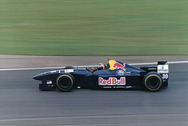 Heinz-Harald Frentzen driving the C14 at the 1995 British Grand Prix.