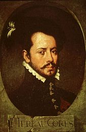 "Old painting of a bearded young man facing slightly to the right. He is wearing a dark jacket with a high collar topped by a white ruff, with ornate buttons down the front, the painting is dark and set in an oval with the letters ""HERNAN CORTES"" in a rectangle underneath."