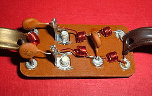 Electronic filter - Television signal splitter consisting of a high-pass filter (left) and a low-pass filter (right). The antenna is connected to the screw terminals to the left of center.