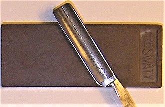 Straight razor - Honing stone and razor blade