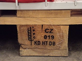 Wood drying - These IPPC markings on a wood pallet indicate KD: kiln-dried, HT: heat treated, and DB: debarked. Essentially all wood packaging material that is exported to an IPPC member state must have a stamp such as this.