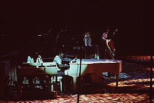 Ian Stewart (musician) - Stewart (center) in 1975 at the grand piano with The Rolling Stones and Billy Preston (left)