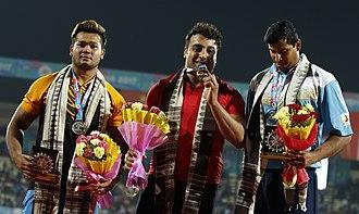Ehsan Haddadi - Iranian Eshan Hadadi, The Gold Medalist, Malaysia's Silver Medalist Muhammed Irfan And Bronze Winner Of India, Vikas Gowda