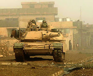 Soldiers from U.S. 3d Armored Cavalry Regiment provide overwatch for troops from their M1 Abrams tank in Biaj, Iraq