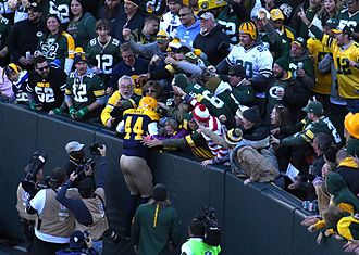 "James Starks doing the ""Lambeau Leap"" James Stark doing the Lambeau Leap (cropped).jpg"