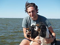 Jason Bellini with his dogs on Great South Bay.jpg