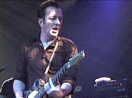 Strummer performing in April 2002