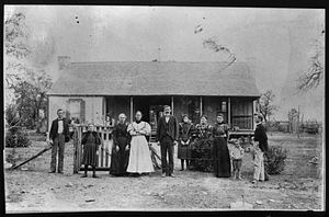 Samuel Ealy Johnson Sr. - The Johnson Family in front of their home (later the birthplace of Lyndon Johnson). Sam Ealy Johnson Sr. (center) with family members. On his right is his wife: Eliza Bunton Johnson, to her right is her mother, Priscilla Jane McIntosh Bunton. in or near Stonewall, Texas.