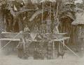 KITLV - 86783 - Stafhell & Kleingrothe - Medan-Deli - Karo Batak women and children, presumably pounding rice on the east coast of Sumatra - circa 1900.tif