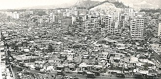 Kowloon Walled City - An aerial view of the Kowloon Walled City and the neighboring Sai Tau Tsuen village in 1972