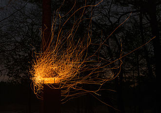 Streamlines, streaklines, and pathlines - A long-exposure photo of spark from a campfire shows the pathlines for the flow of hot air.