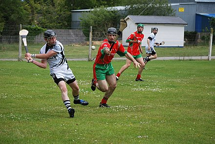A club hurling match in play, after the helmet regulation Killyon vrs Longwood - Meath Senior Hurling Championship 2011 (5849114092).jpg
