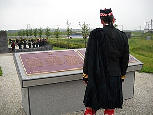 Battle of Walcheren Causeway - Lieutenant Colonel Mike Vernon, CD, Commanding Officer of The Calgary Highlanders, ponders the monument to the 5th Canadian Infantry Brigade