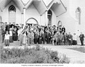 Large group of men and women posing on steps of the Metlakatla Christian Mission church, ca 1914 (CURTIS 1928).jpeg