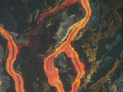 Figure 8.11: In effusive eruptions, lava flows more readily, producing rivers of molten rock.