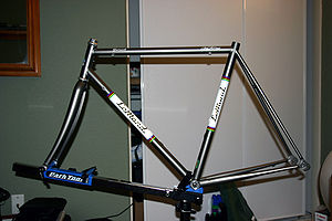 Steel frame and carbon fiber fork of 2000 LeMond Zurich racing bicycle mounted in a work stand.