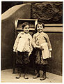 Lewis Hine, Willie Cohen and Max Rafalovizht, 8 years of age, newsboys, Philadelphia, 1910.jpg