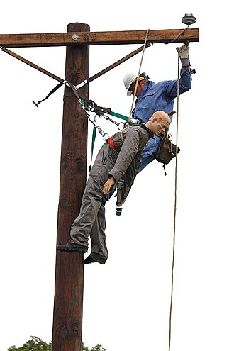 Lineworker - Ameren lineman practicing a utility pole rescue