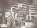 Log cabin interior, circa 1913.png