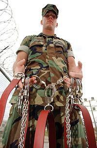 MP displays Guantanamo shackles.jpg