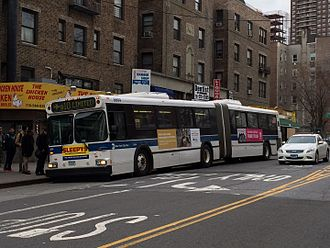 Q10 (New York City bus) - A JFK Airport-bound Q10 entering service near the Union Turnpike station.