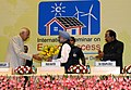 """Manmohan Singh being welcomed by the Union Minister for New and Renewable Energy, Dr. Farooq Abdullah, at the """"International Seminar on Energy Access"""", in New Delhi. The Union Minister for Corporate Affairs and Power.jpg"""