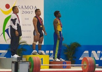 2007 Pacific Games - Gold medalist Manuel Minginfel of the Federated States of Micronesia on the medal dais with fellow weightlifting competitors from the 56 kg weight class.