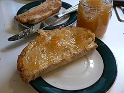 Marmalade spread on a slice of bread
