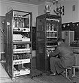 Mechanic Kauko Mustakallio manufacturing a frequence modulated 1kW transmitter, its electronic power converter and output stage in Yleisradio's workshop, 1946. (15464822116).jpg