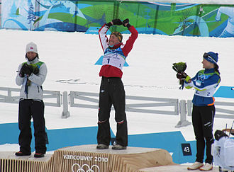 Cross-country skiing at the 2010 Winter Olympics – Women's 30 kilometre classical - Medal ceremony for the event. From left: Marit Bjørgen (silver), Justyna Kowalczyk (gold), Aino-Kaisa Saarinen (bronze)