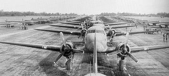 RAF Membury - Douglas C-47s and CG-4A Waco Gliders lined up on the runway at Membury Airfield, 1944.